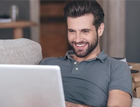 single male teacher using laptop