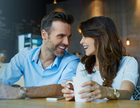 Couple sharing questions in a cafe