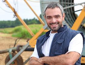 Single farmer with a thresher