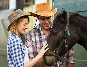 farming couple with a horse