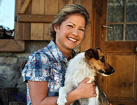 Single farmer with her dog