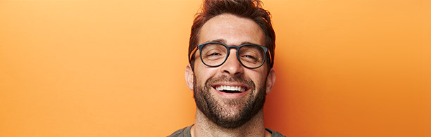 handsome bespectacled man laughing