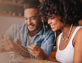 smiling couple listening to music