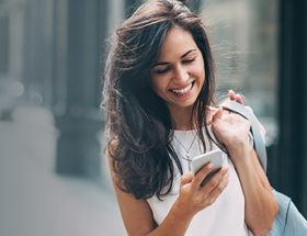 women smiling look at phone