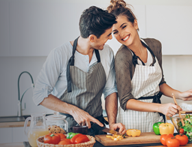 Couple cooking a vegan dinner together