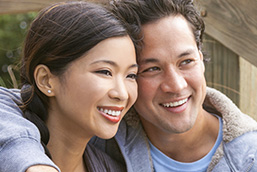 asian couple laughing together