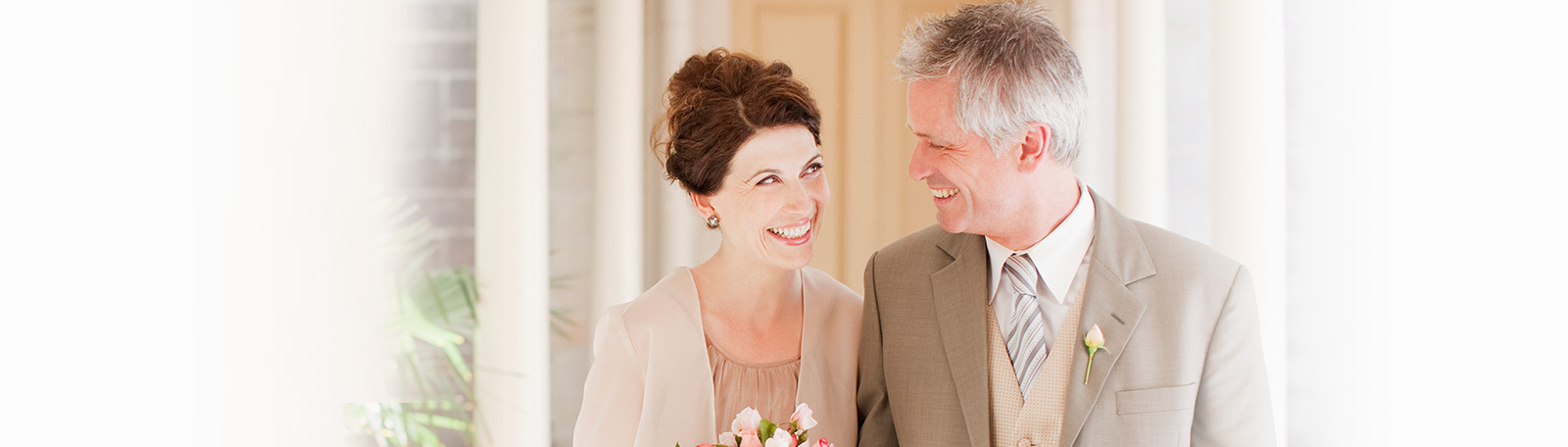 classy older couple smiling