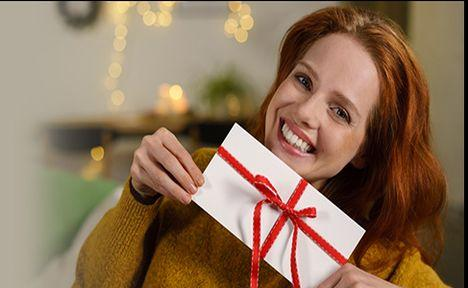 woman holding wrapped gift