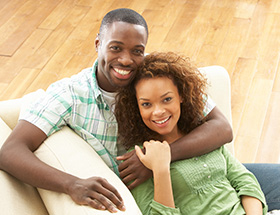 Attractive black couple smiling