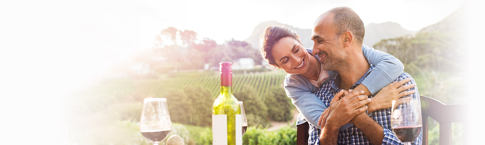 relaxed couple outside with wine