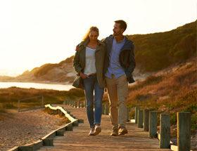 couple walking on pier