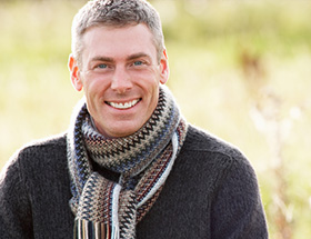 rich older man with a scarf
