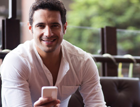 Handsome Italian man on his smartphone