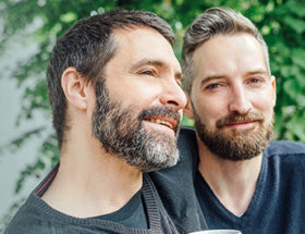 handsome bearded gay couple outside