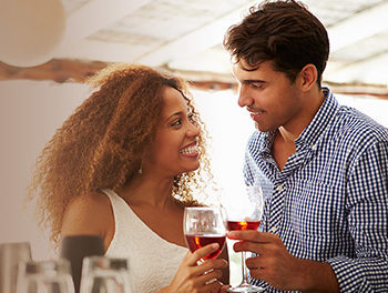 attractive couple drinking wine and smiling