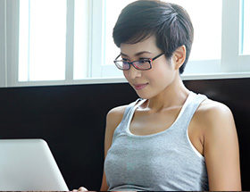 intelligent looking woman with laptop