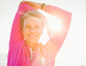 healthy and fit older woman stretching