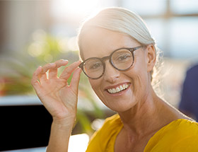 smiling older woman with glasses