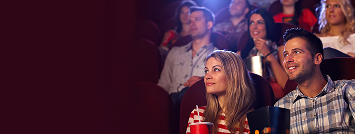 couple sitting in cinema smiling