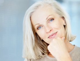 older woman thinking about relationship