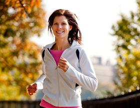 Woman jogging in Autumn